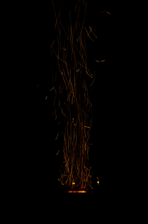 Fire sparks on black background.