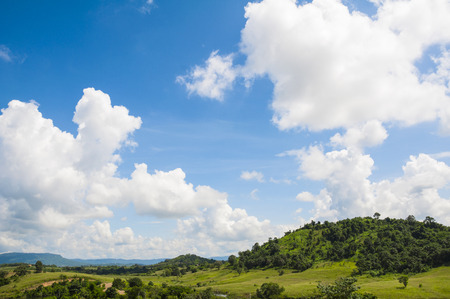 Green field and mountains with cloudy and blue sky. at Flora Park ,Wangnamkeaw - Nakhon Ratchasima , Thailand. Banco de Imagens - 51286896