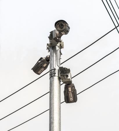 Camera cctv with cables and sky. Banco de Imagens