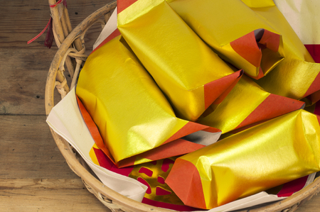 Joss Paper Chinese Tradition (Silver/Gold Paper) for passed away ancestor's spirits on wooden board. Banco de Imagens