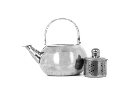 Tea Kettle with Tea Strainer isolated on white background.