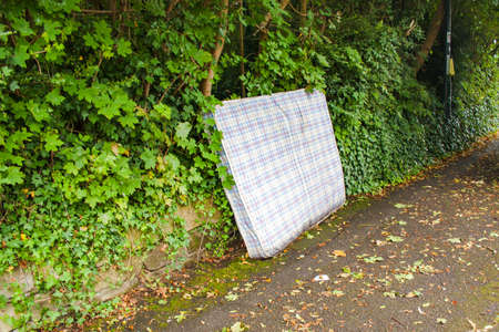 Discarded Matress in Street Stock Photo
