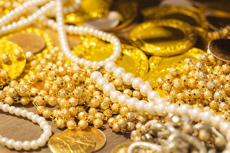 Golden coin and jewerly Stock Photo