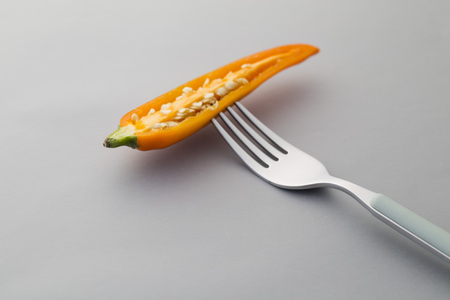 Slice Yellow Chili pepper on a fork