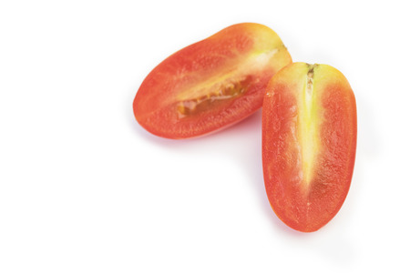 Slice Red grape chrerry tomato on white background