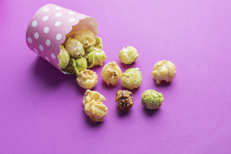 various tastes homemade popcorn on pink background