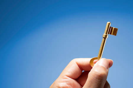 Hand holding the key to success