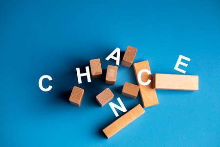 """Random text """"CHANCE"""" around wooden pegs"""
