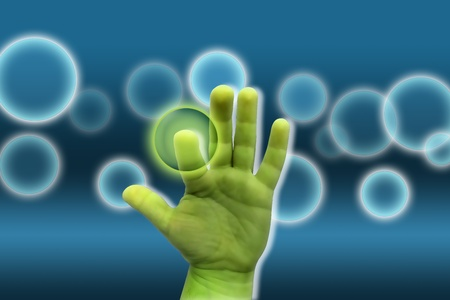 green hand on a blue background pressing magic bubble