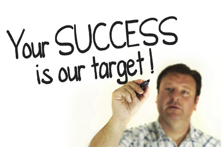 person writing: A person writing and pointing Your success is our target