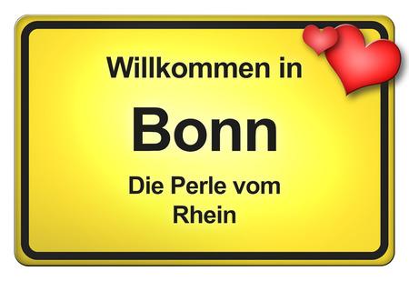 ortseingangsschild: Ein gelbes Ortseingangsschild mit freundlicher Willkommens - Begr ?? ung