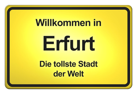 German yellow city limit sign with friendly greetings Stockfoto