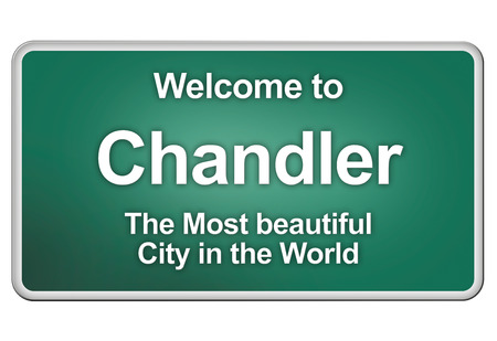 chandler: Green village sign with friendly Greetings Stock Photo