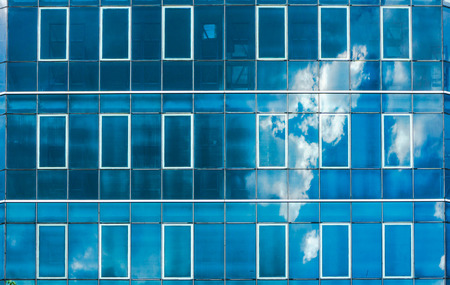 window reflection: facade building cloud in background