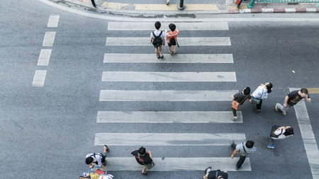 crosswalk: People across the crosswalk on top view