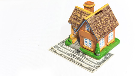 australian dollar notes: House toy on money bank notes in white backgound Stock Photo