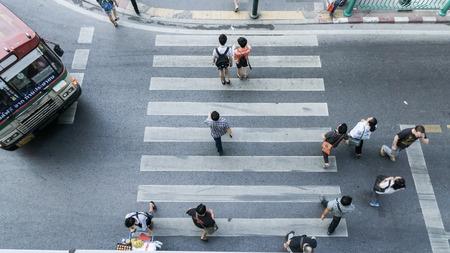 across: People across the crosswalk on top view