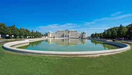 Beautiful view of famous Schloss Belvedere with a reflectant pool and blue sky, in Vienna, Austria Editorial