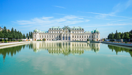Beautiful view of famous Schloss Belvedere with a reflectant pool and blue sky, in Vienna, Austria Stock Photo