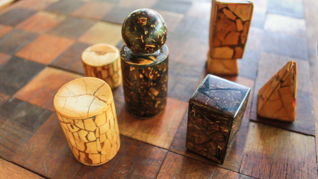 Board for a game of wood brock and wood cube on the chess background