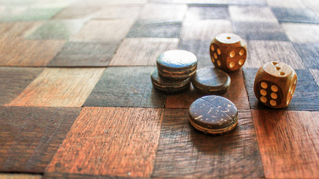 Board for a game with two dices which show the high point of five and six points. Stock Photo
