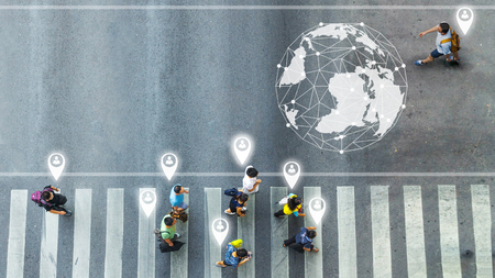 concept art of person icon with world social network connecting of one man walk , the busy city crowd move to pedestrian crosswalk on businees traffric road (Aerial photo, top view) Editorial
