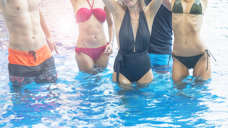 Fashion of underwear summer beach bikini slim women and musle men people in top nude dance party with water splash in swimming pool