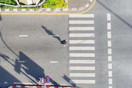 people walk on across business city street (Aerial top view) Stock Photo