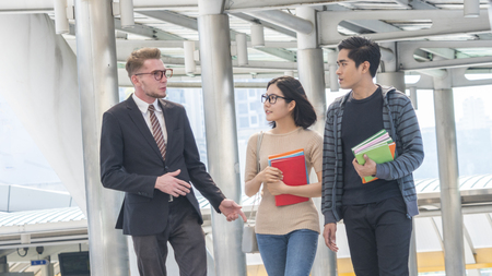 group of teacher and students teen walk in rush time at outdoor Stock Photo