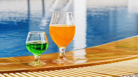 Summer beverage colorful cocktail at swimming pool