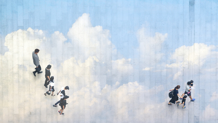 The double exposure image of top view of people walk on street with the reflection of sky and cloud. Concept city life and nature.