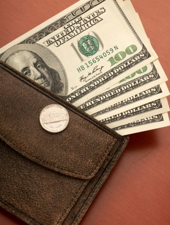 hz: Brown leather wallet with money Stock Photo