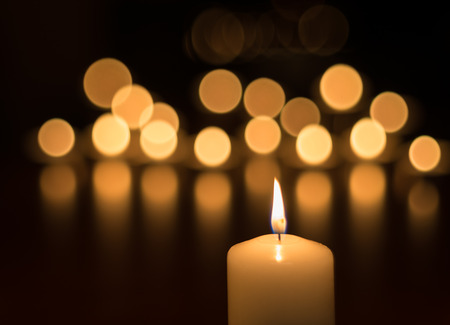Candles in darkness