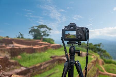 tripod mounted: Photo camera mounted on tripod outdoors Stock Photo