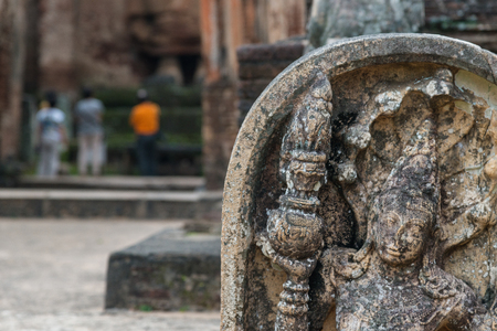 polonnaruwa: Traditional asian bas relief in ancient palace in Polonnaruwa, Sri Lanka, tourists on background Stock Photo