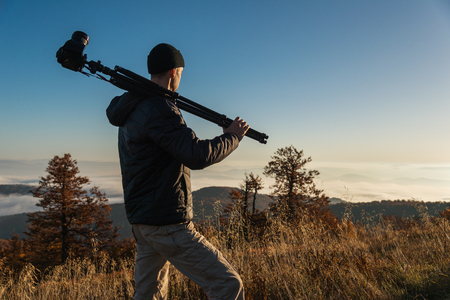 Photographer with camera in mountains