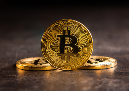 Golden bitcoin on dark background Stock Photo