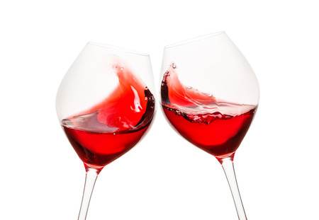 Toasting glasses with red wine