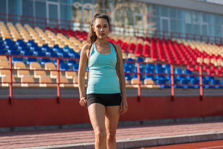 Young sporty woman with skipping rope in stadium Imagens