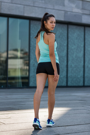 Portrait of young attractive fitness woman Imagens
