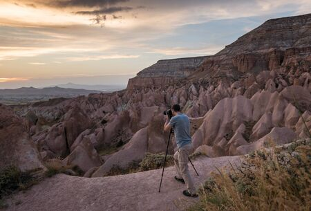 Photographer taking picture at sunset in Cappadocia 写真素材