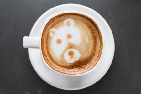 A cup of coffee with bear image photo