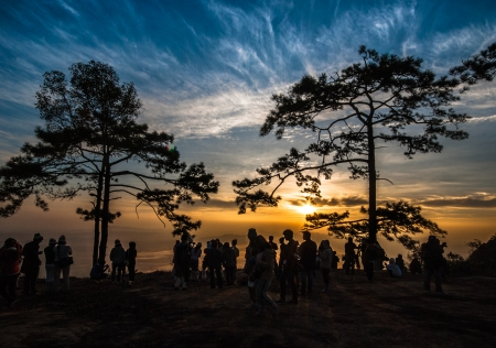 KA: silhouette of people  during sunset