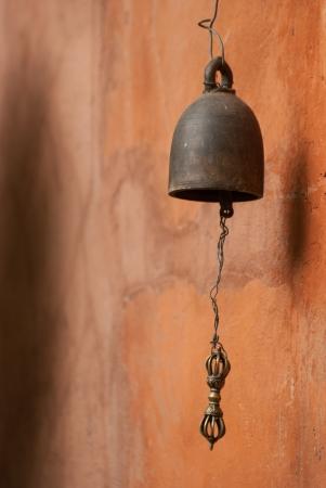 buddhist structures: Thai bell on orange wall
