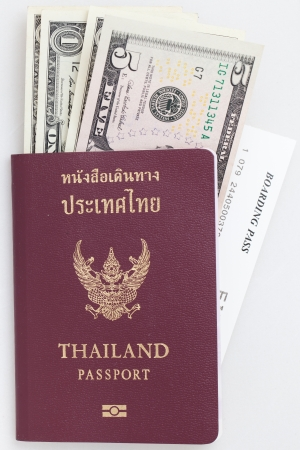 Thai passport bank note and boarding pass photo
