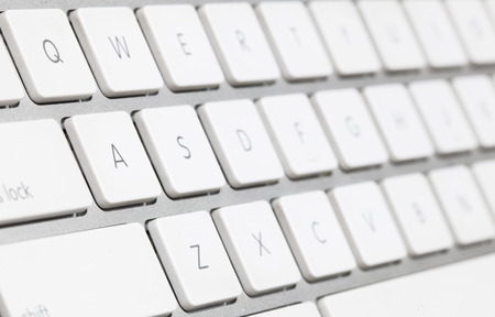 close up of a white keyboard english alphabet. photo