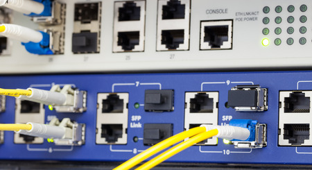 Optic fiber and SFP connected to switch. photo