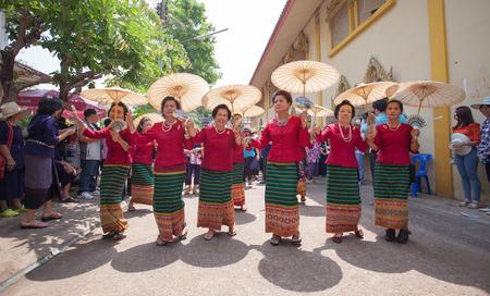 SUKHOTHAI - APRIL 7 : Songkran Festival and Had Siew Elephant Ordains at Si Satchanalai from April 7 to 8, Riding on elephant and Thai Puan elephant ordination on April 7, 2014 in Sukhothai,Thailand. Stock Photo - 27442243