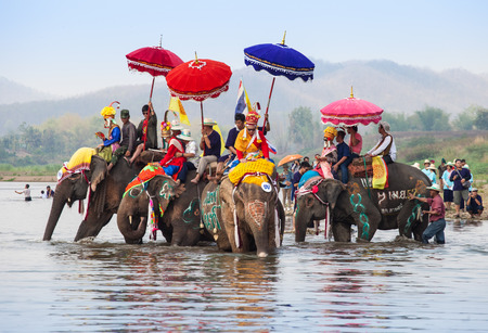 SUKHOTHAI - APRIL 7   Songkran Festival and Had Siew Elephant Ordains at Si Satchanalai from April 7 to 8, Riding on elephant and Thai Puan elephant ordination on April 7, 2014 in Sukhothai,Thailand  Stock Photo - 27442250