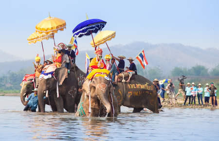SUKHOTHAI - APRIL 7   Songkran Festival and Had Siew Elephant Ordains at Si Satchanalai from April 7 to 8, Riding on elephant and Thai Puan elephant ordination on April 7, 2014 in Sukhothai,Thailand  Stock Photo - 27442251